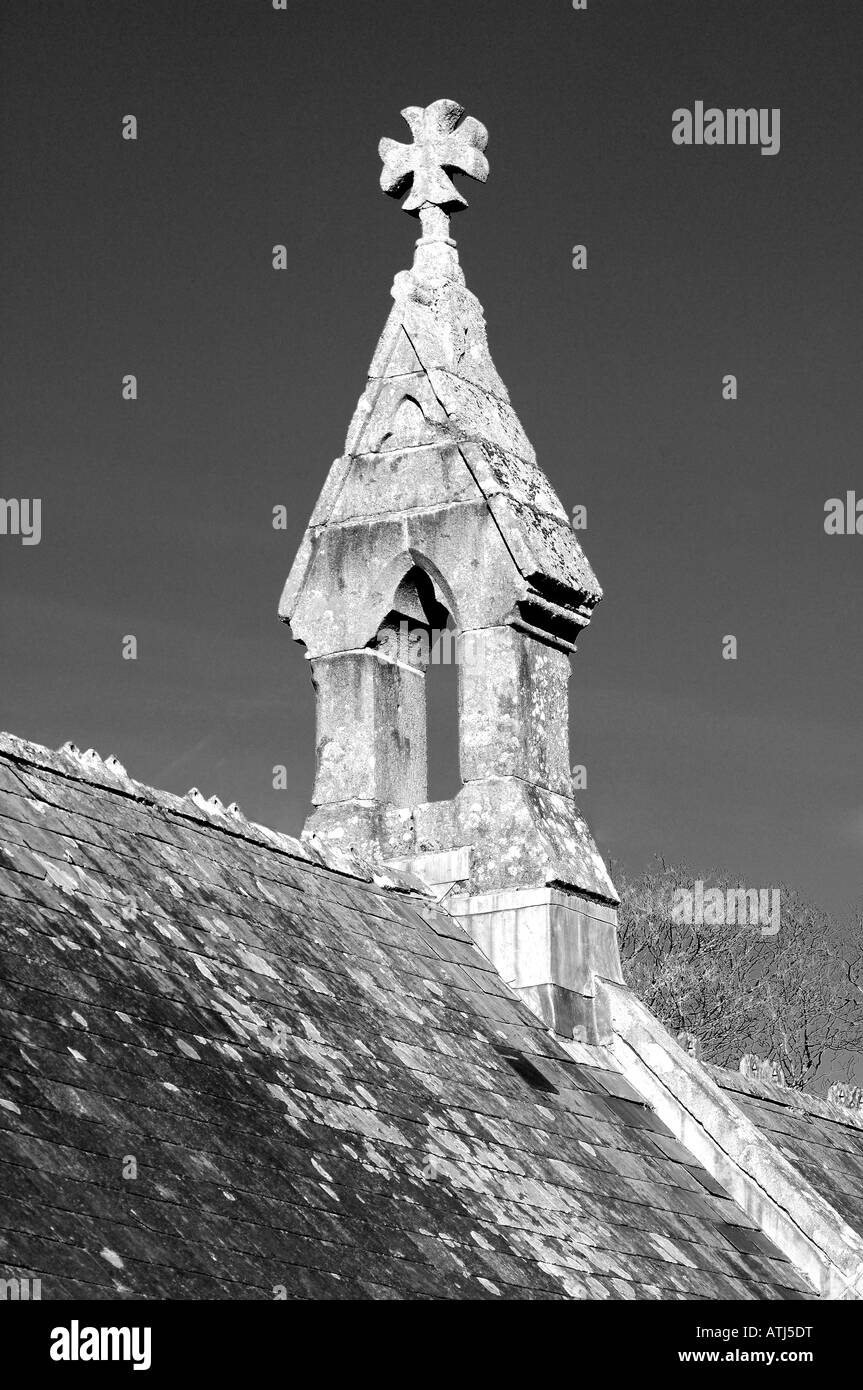 An empty bell tower on top of a church in black and white with plain sky - Stock Image