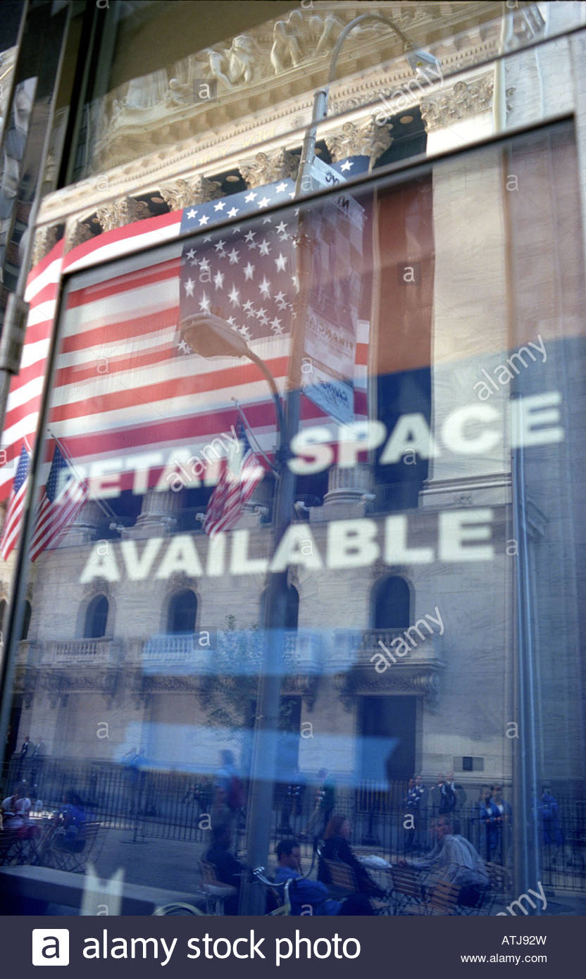 Relection in window opposite the Stock Exchange in Manhattan New York with retail rental space available sign USA - Stock Image