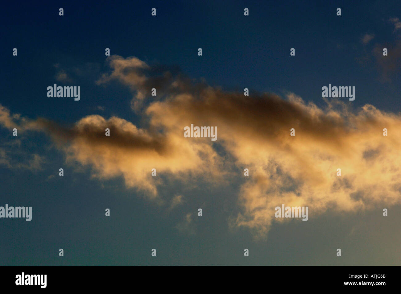 Evening Sky & Warm Coloured Clouds Stock Photo