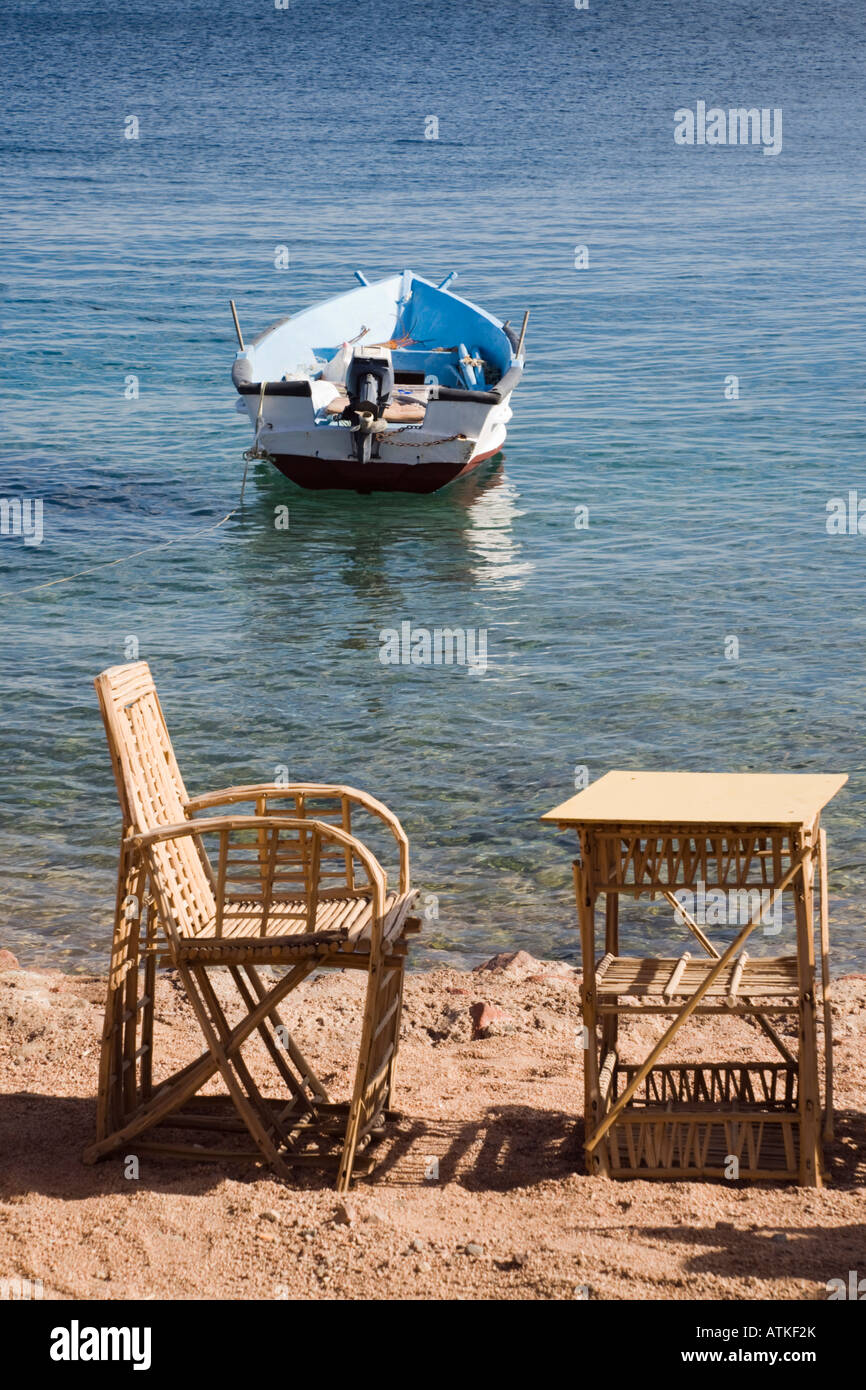 Dahab Sinai Peninsula Egypt Asia. Table and chair on beach in seaside resort on Red Sea east coast - Stock Image