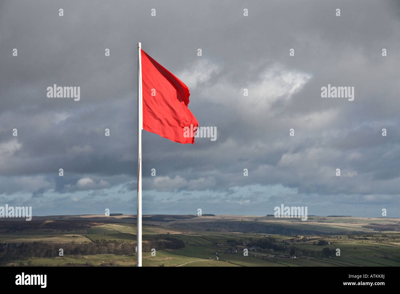 Red flag on the edge of Army training land in Swaledale, Yorkshire. - Stock Image