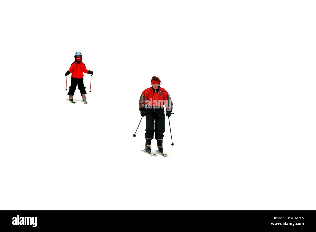 Skiers snowboarders skiing snowboarding on the pistes of the Schmittenhohe mountain above Zell am See  - Stock Image