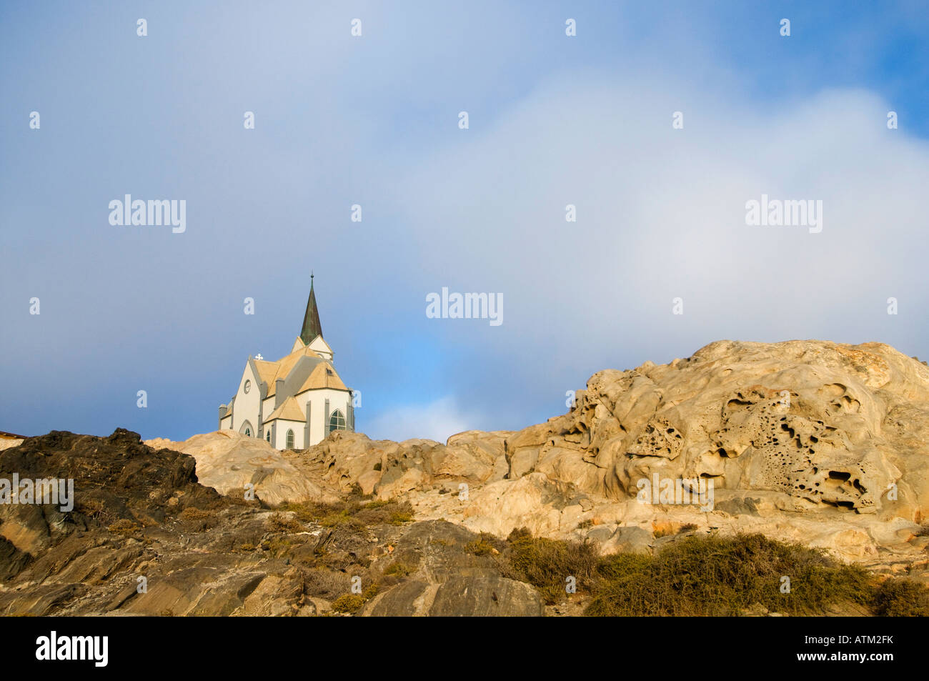 Felsenkirche or Church of the Rock looks over Luderitz Namibia founded as a harbour town - Stock Image