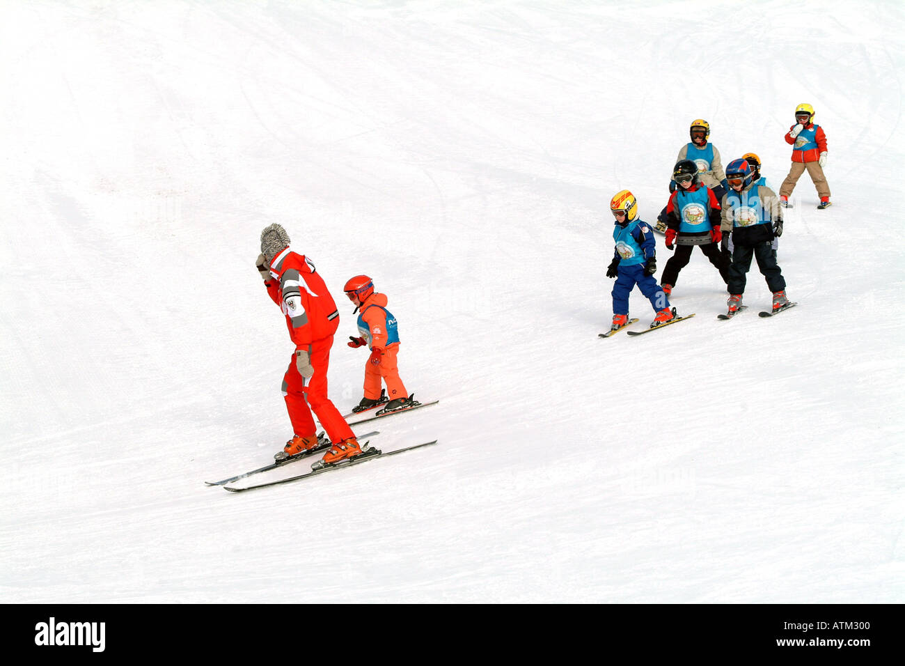 Children getting ski instruction on the pistes of the Schmittenhohe mountain above Zell am See  - Stock Image
