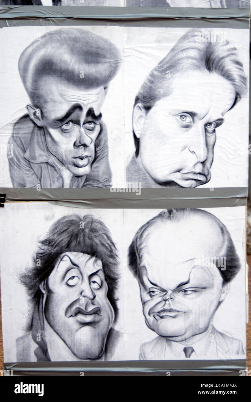 Caricatures of famous American actors drawn by Leicester Square street portrait artist London England UK - Stock Image