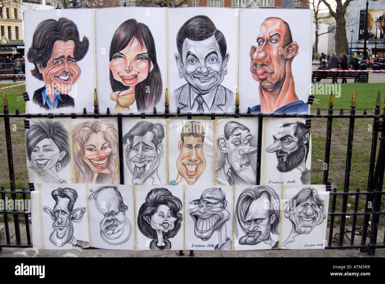 Caricatures of famous people in Leicester Square London England UK - Stock Image