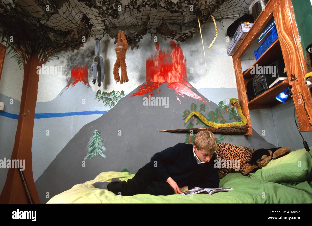 Boy Reading In Hammock In Jungle Themed Bedroom Luke Hanna Stock Photo Alamy