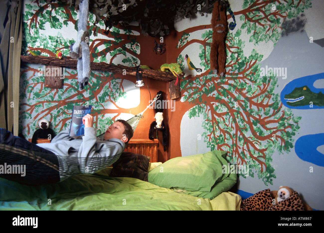 Boy Reading In Hammock In Jungle Themed Bedroom Oscar Hanna