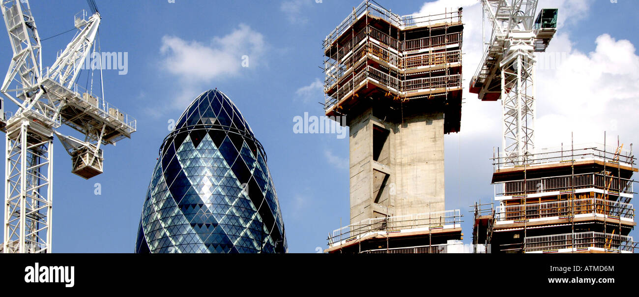 The Gherkin along side a building under construction - Stock Image