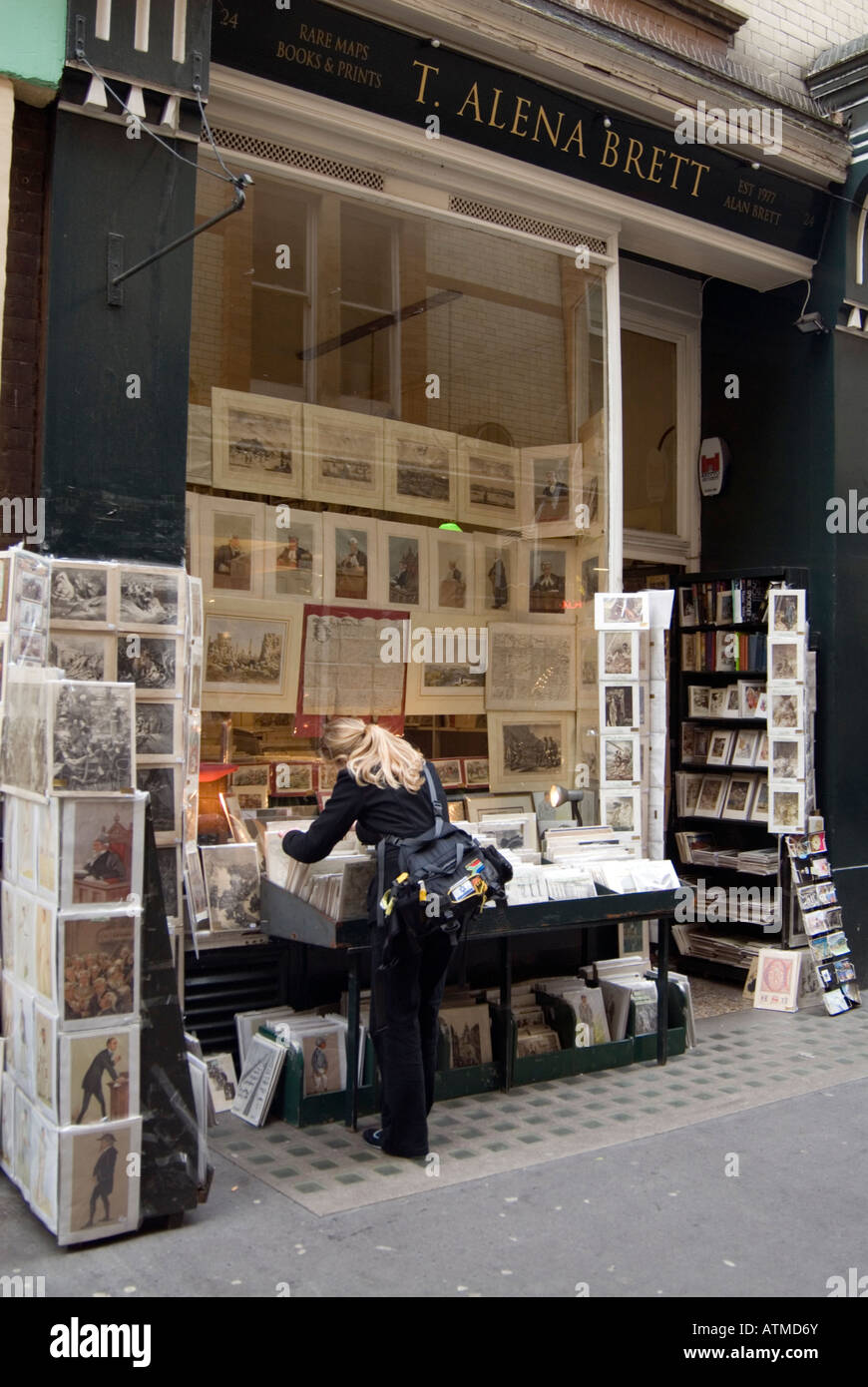 Rare and antiquarian posters and cards in Cecil Court, London England UK - Stock Image