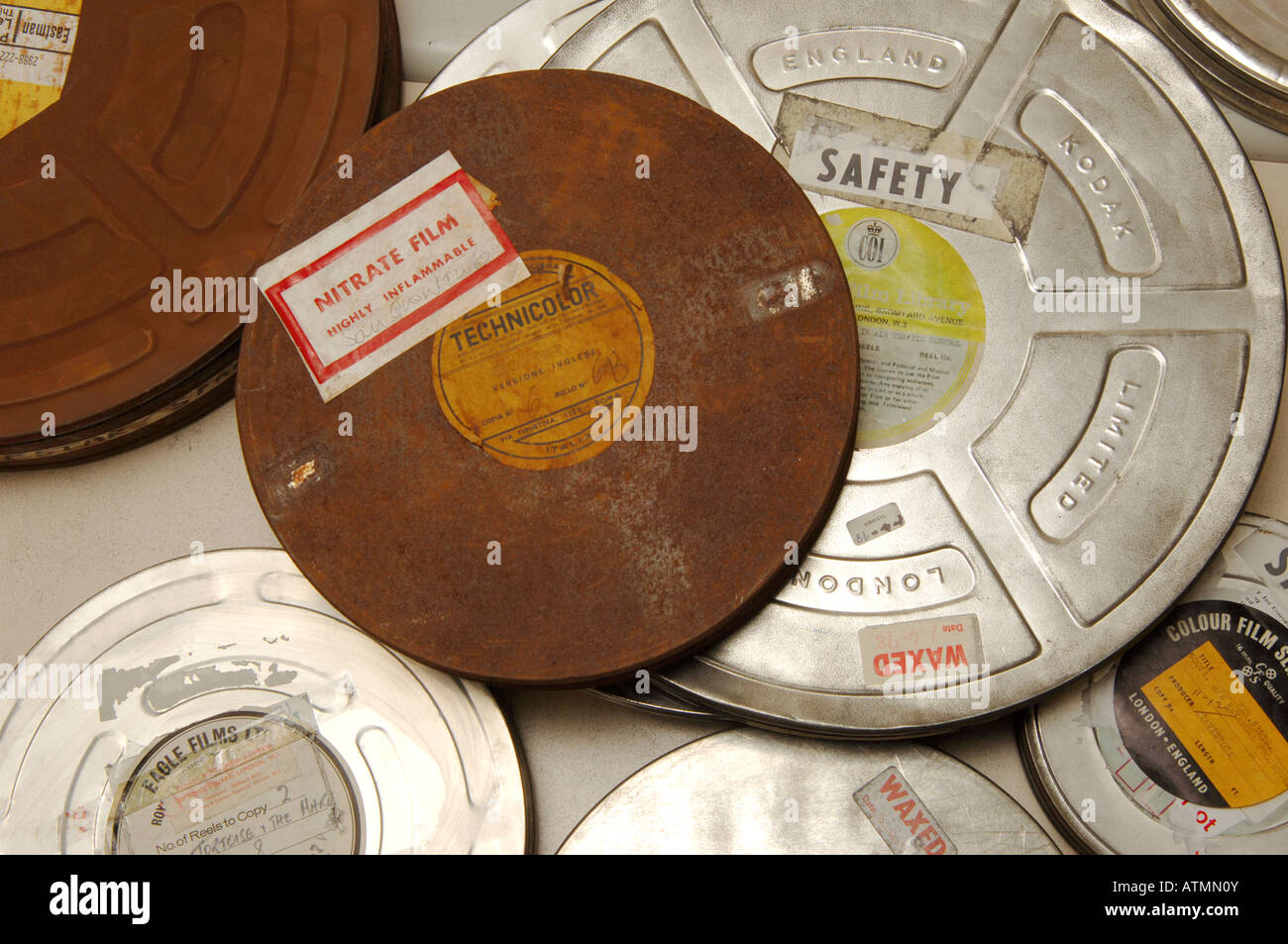 Old film canisters containing nitrate technicolor films - Stock Image