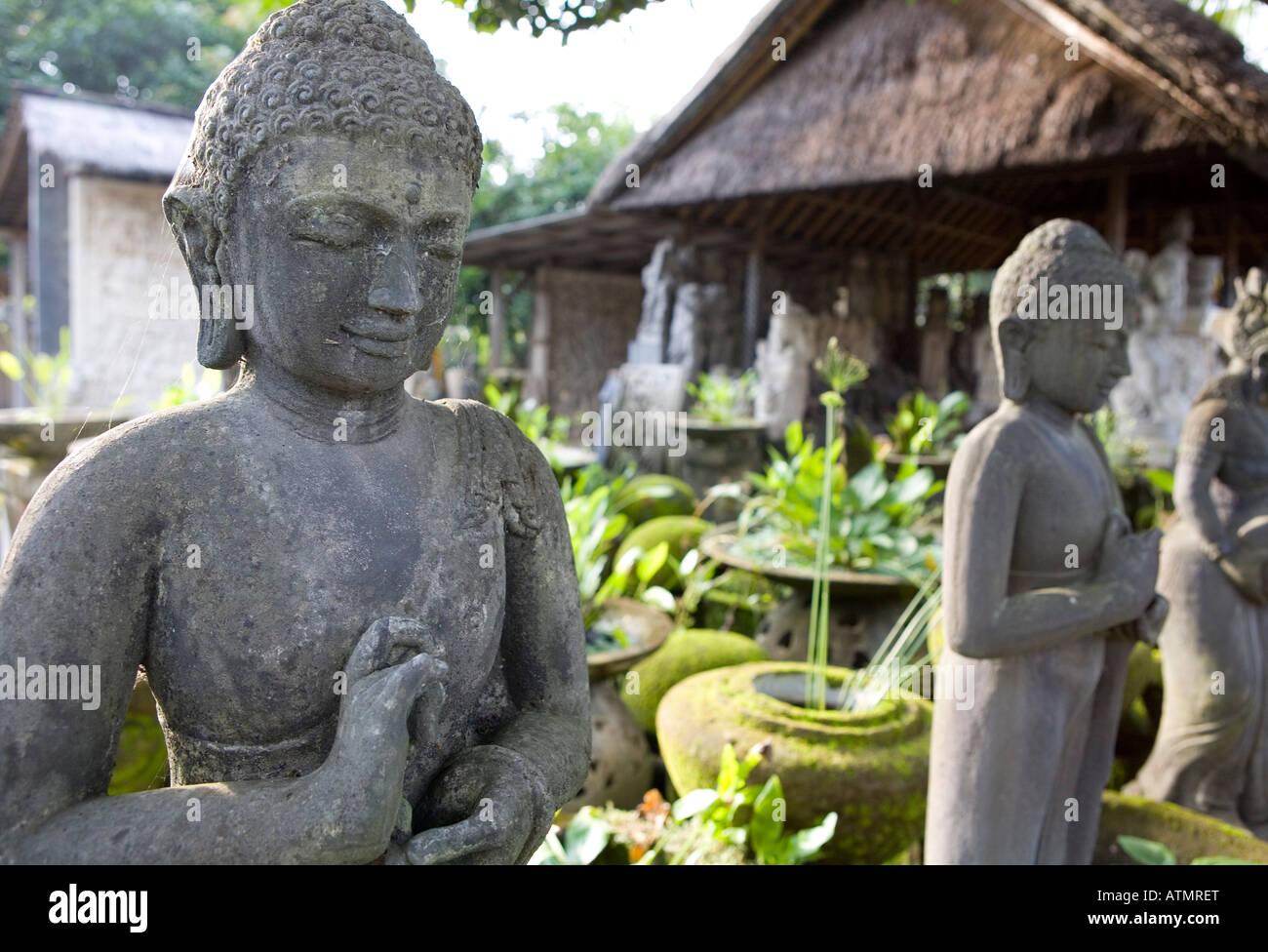 Carved Stone Buddhas Ubud Bali Indonesia - Stock Image