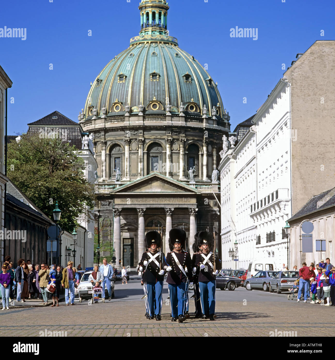 Royal life guards marching in front of Frederik's church, the Marble church, Copenhagen, Denmark - Stock Image
