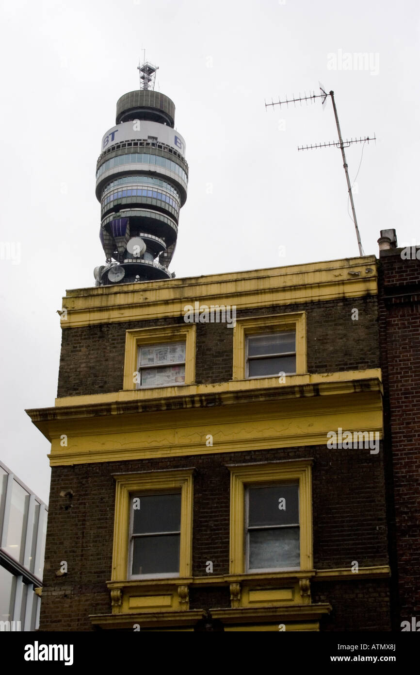 Post office tower British telecom tower with old building in the foreground with television aerial - Stock Image