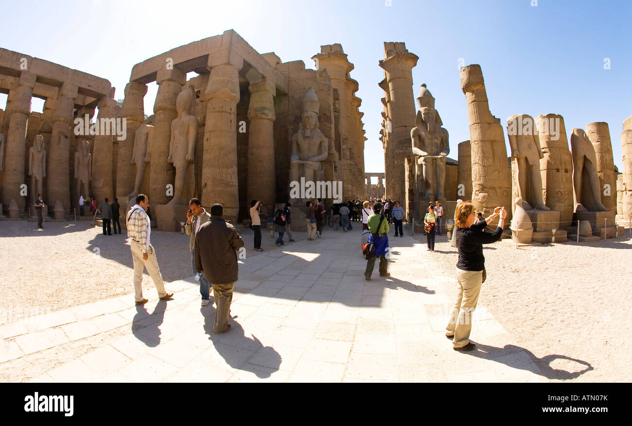 Luxor Temple courtyard with colonnade and large statues of Ramses II Egypt North Africa - Stock Image