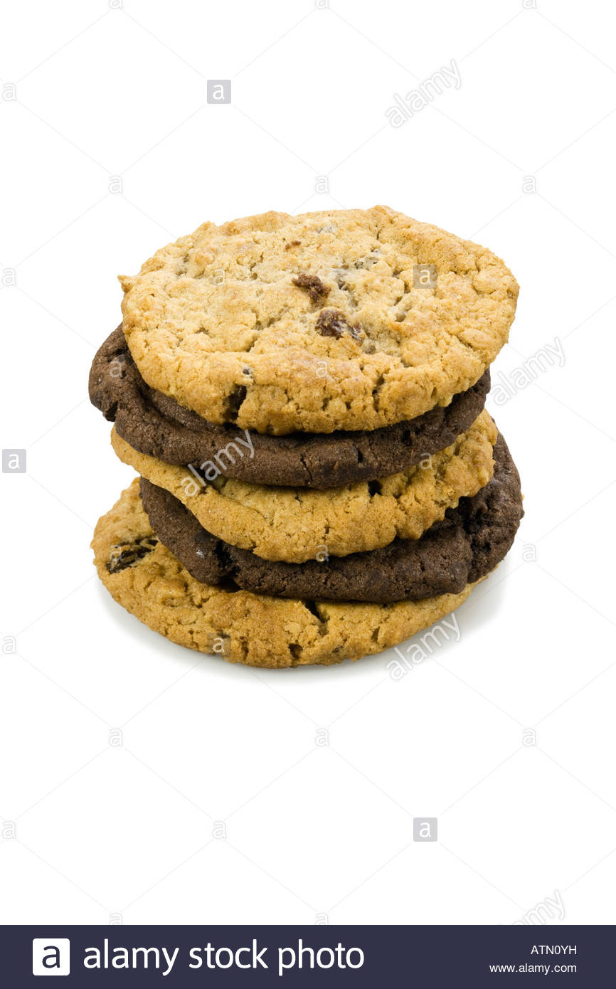 Mixed stack of cookies. Chocolate chip and oatmeal raisin cookies. Stock Photo