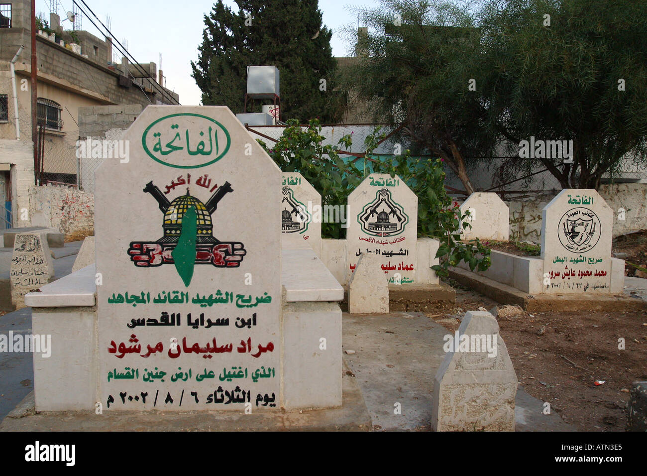 The grave of one of the many Martyrs killed during the 2nd Intifada who is buried in the Balata camp graveyard - Stock Image