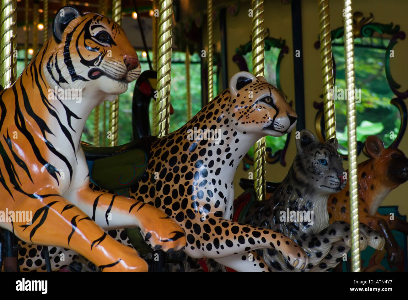 a tiger cheetah and snow leopard figures on a carousel in the st