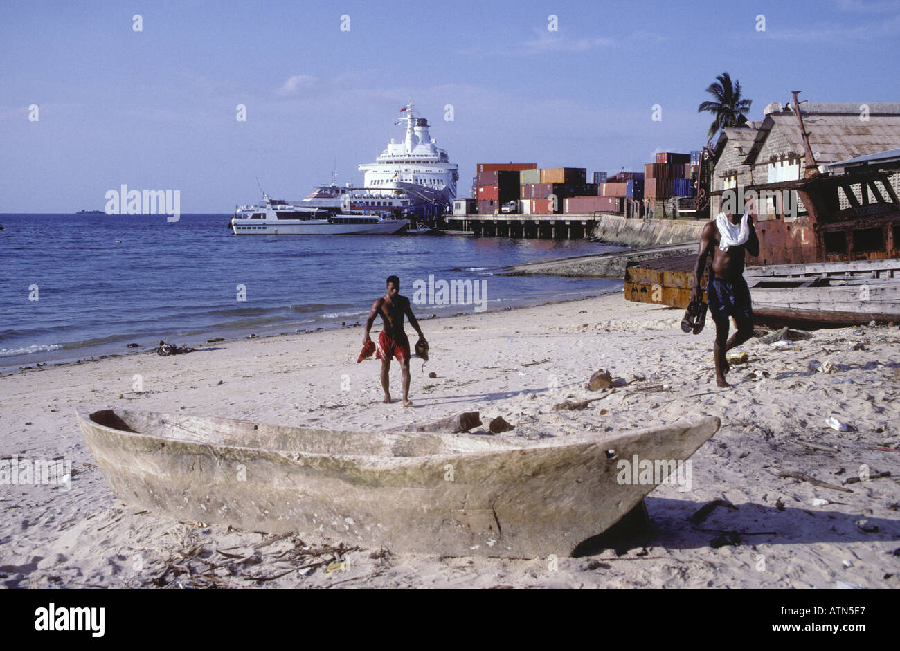 Two young black African men after a swim Zanzibar Tanzania East Africa - Stock Image