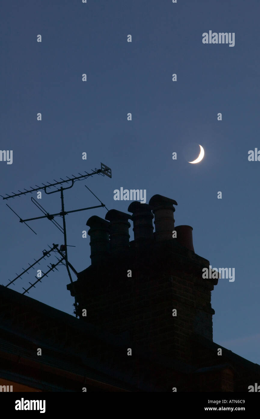 new moon over chimney pot - Stock Image