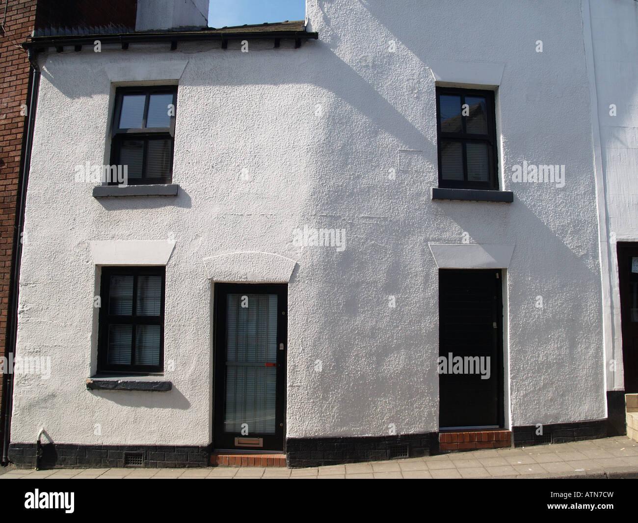 Curved bent white house black windows doors