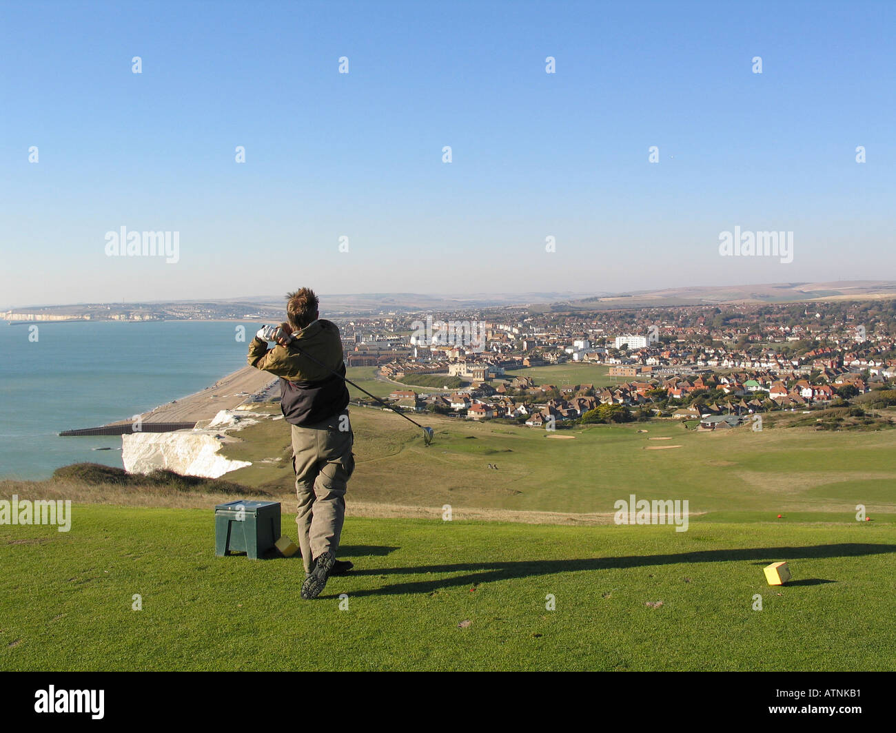 A golfer on the Seaford Head golf course on the South downs in Britain - Stock Image