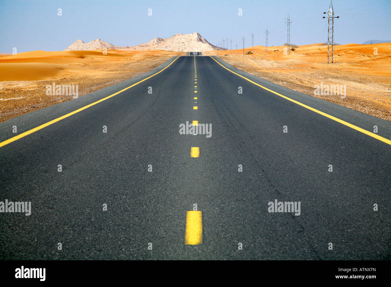 Endless desert road- Dubai - Stock Image