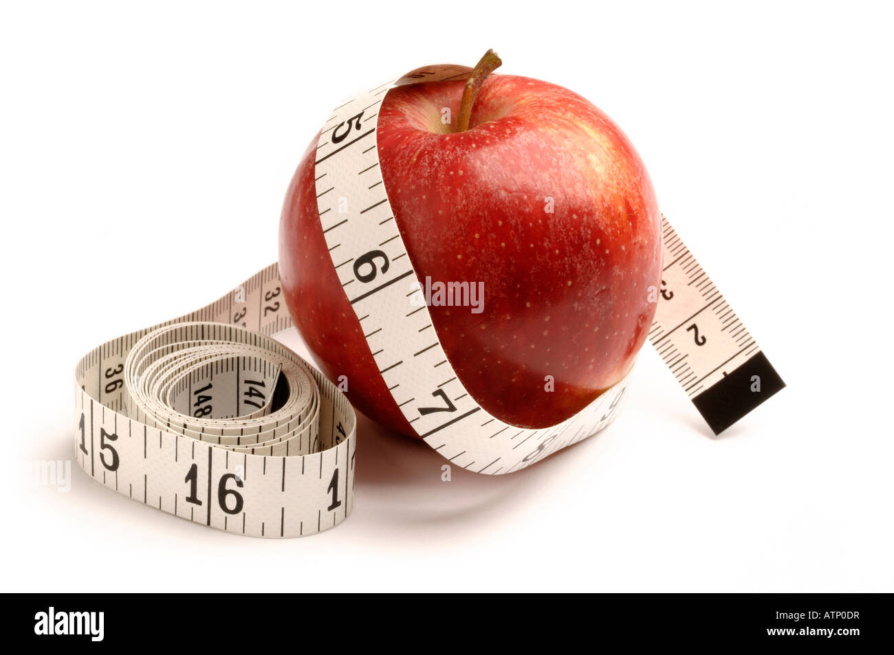 Red apple and tape measure - Stock Image