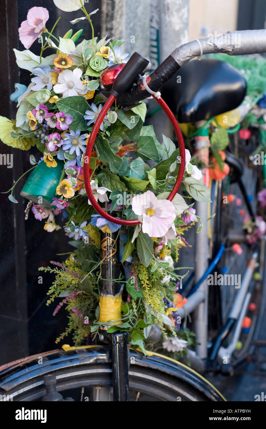 A bicycle in Amsterdam decorated with flowers. Stock Photo