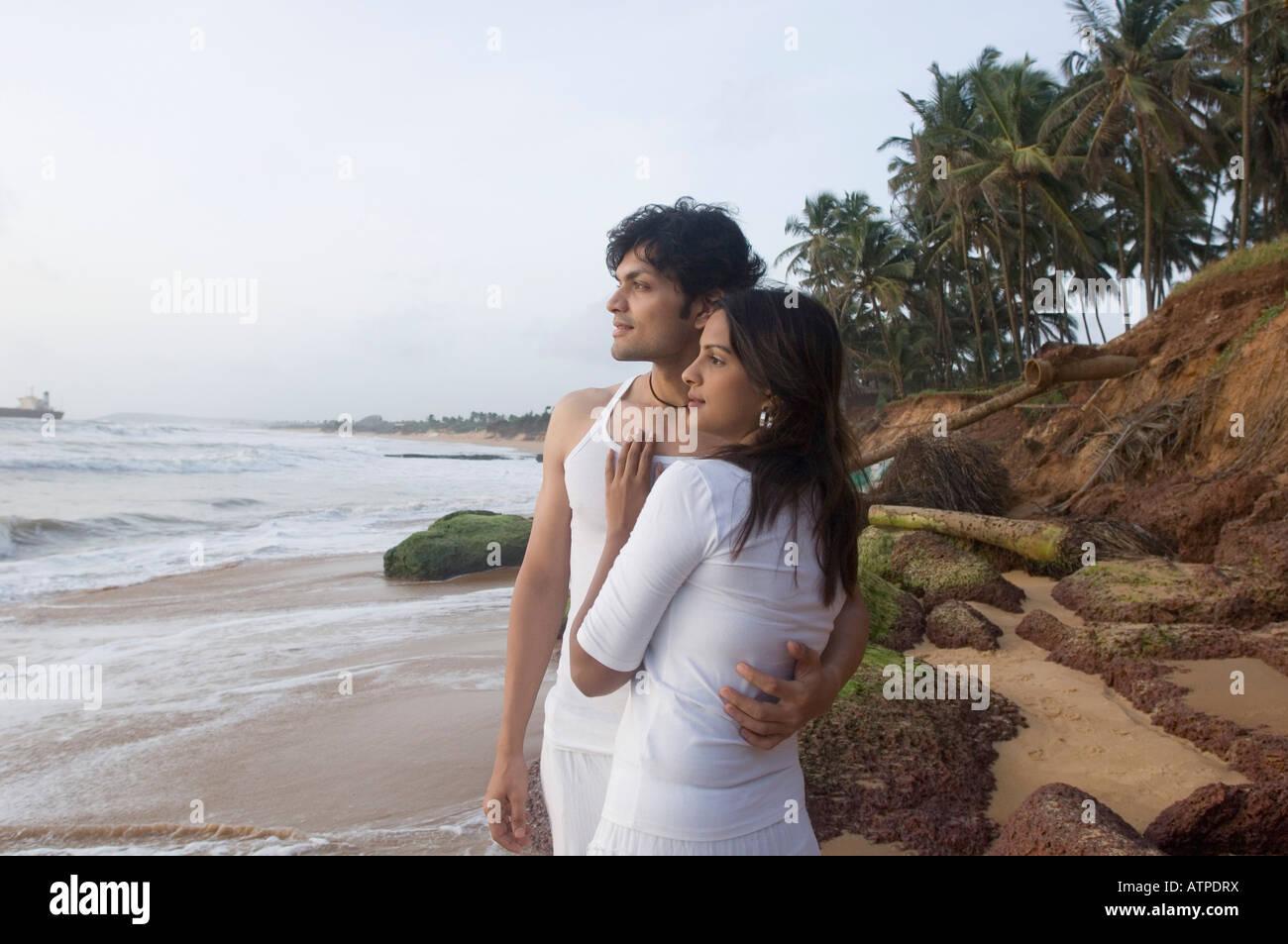 Romantic nude couple beach
