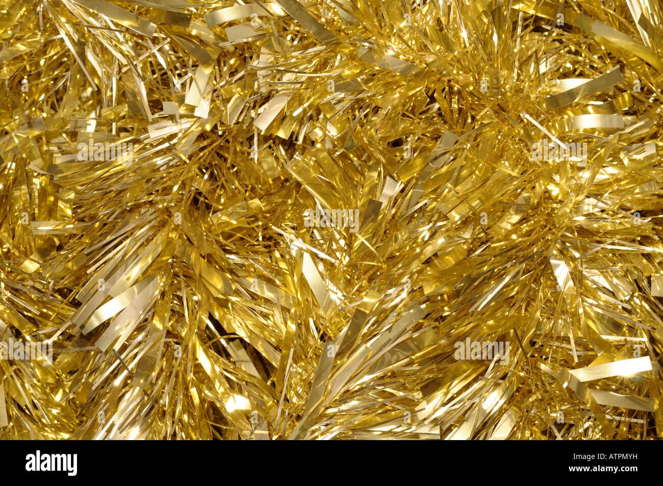 Gold tinsel - Stock Image