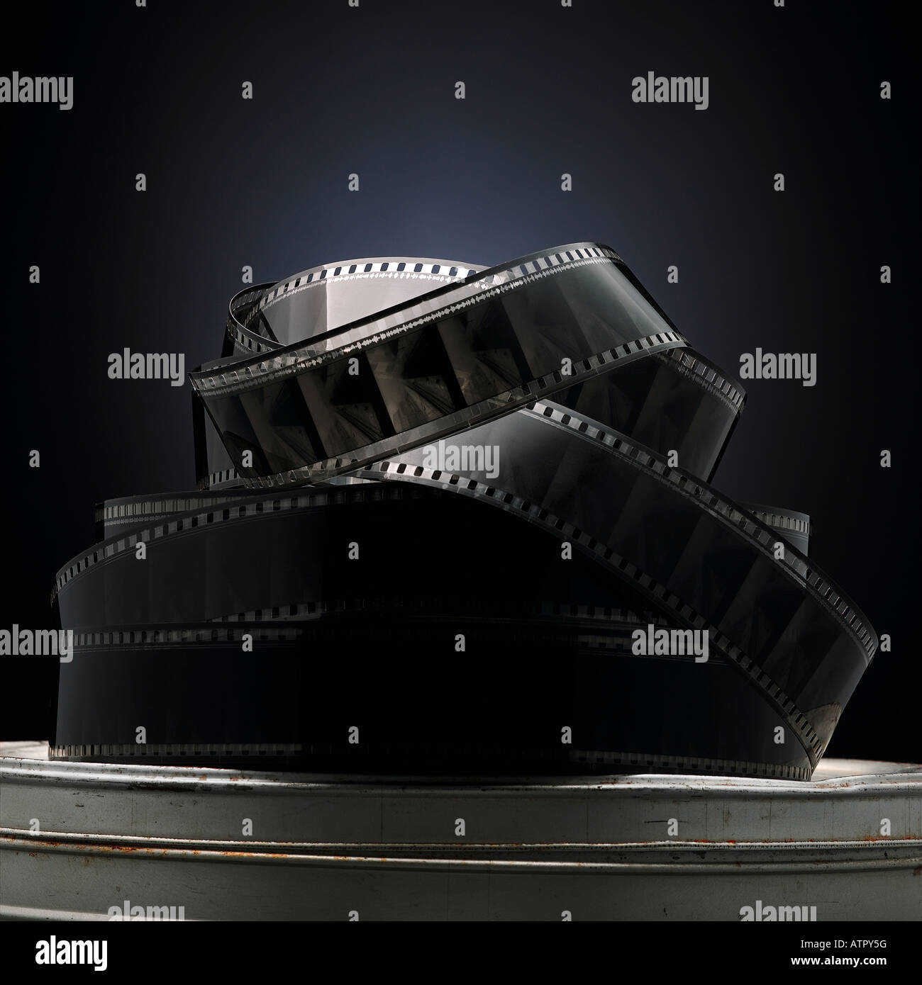jumbled reel of film on a canister - Stock Image