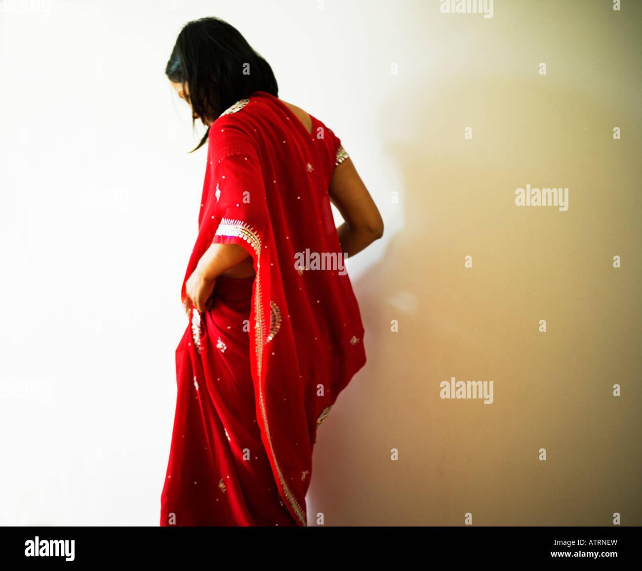 Woman in red sari - Stock Image