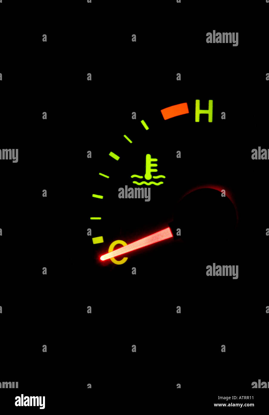 Automobile dashboard temperature guage at night - Stock Image