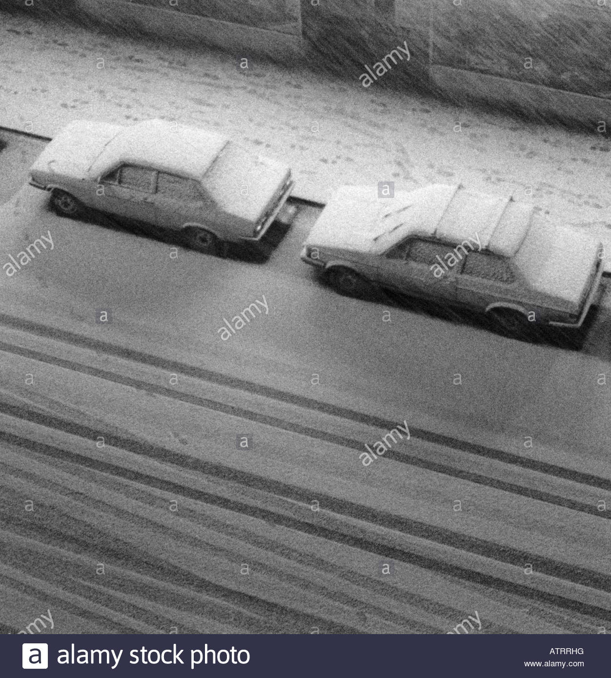 Cars parked outdoors covered with snow Stock Photo