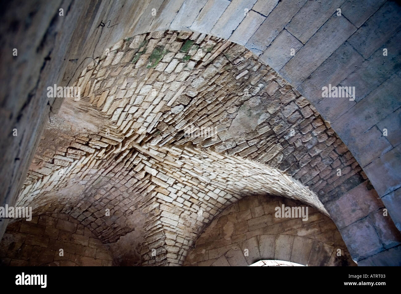 High vaulted gothic style arched ceilings and stone doorways, Crac des Chavaliers, Syria, Middle East. DSC_6053 - Stock Image