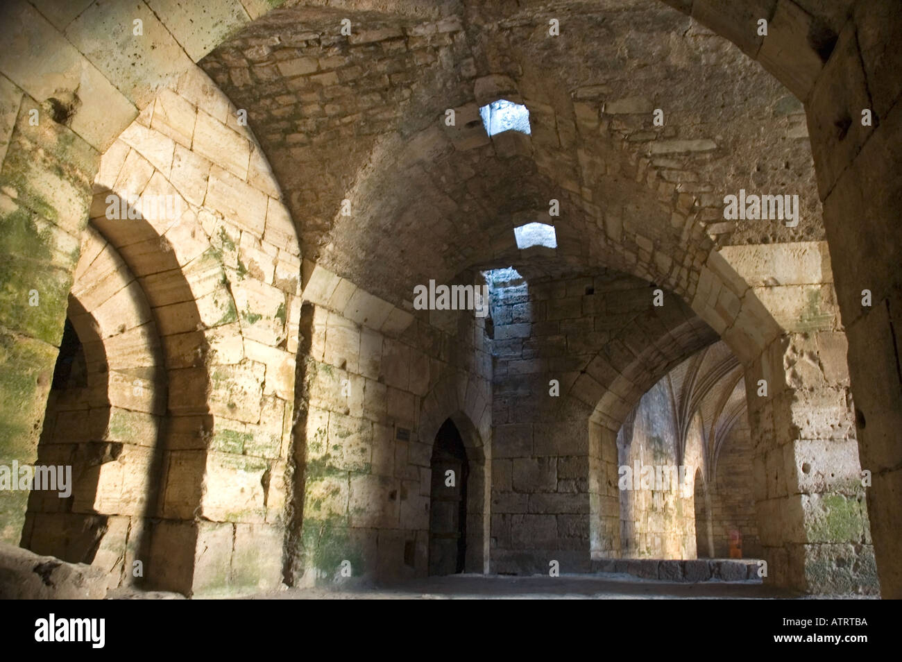 High vaulted gothic style arched ceilings and stone doorways, Crac des Chavaliers, Syria, Middle East. DSC_6099 - Stock Image