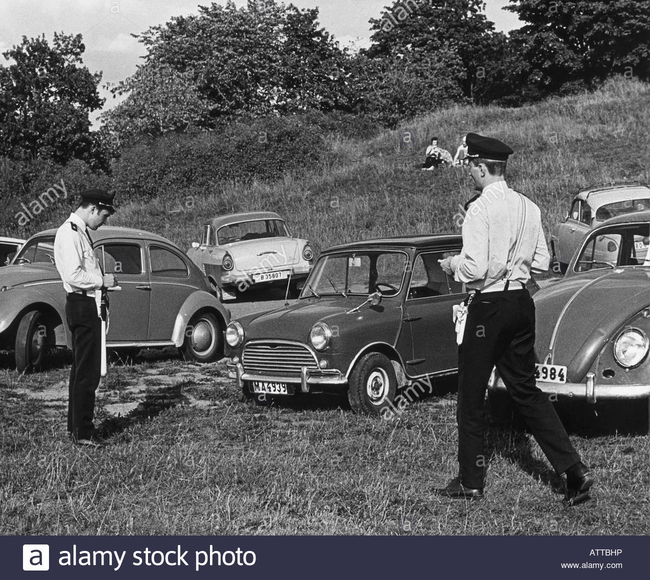 Traffic police by the cars parked in the parking - Stock Image