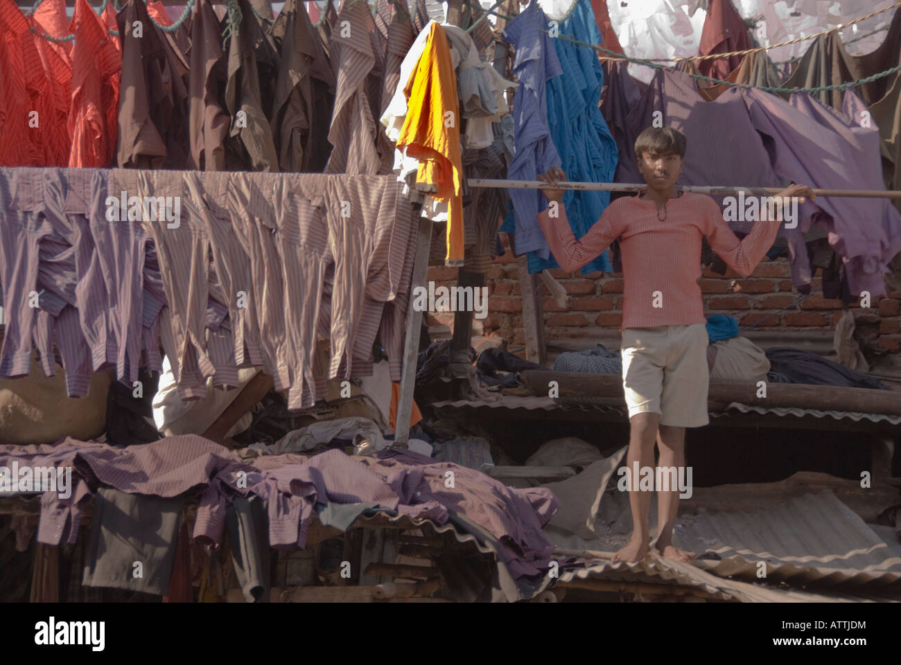 Hanging the shirts out to dry in the outdoor laundry of Mumbai, India. - Stock Image