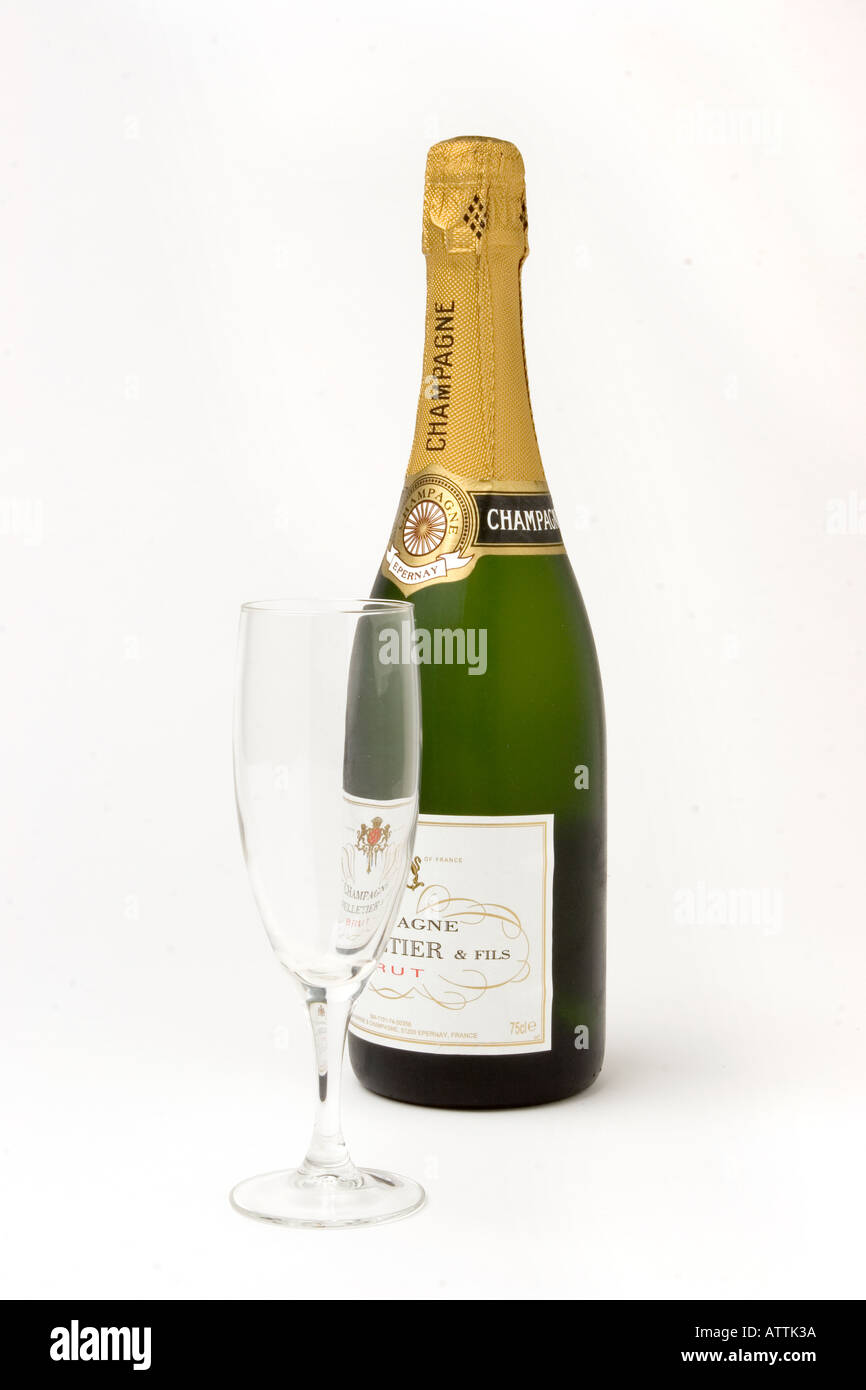 drink unopened bottle of champagne with one flute glass Stock Photo