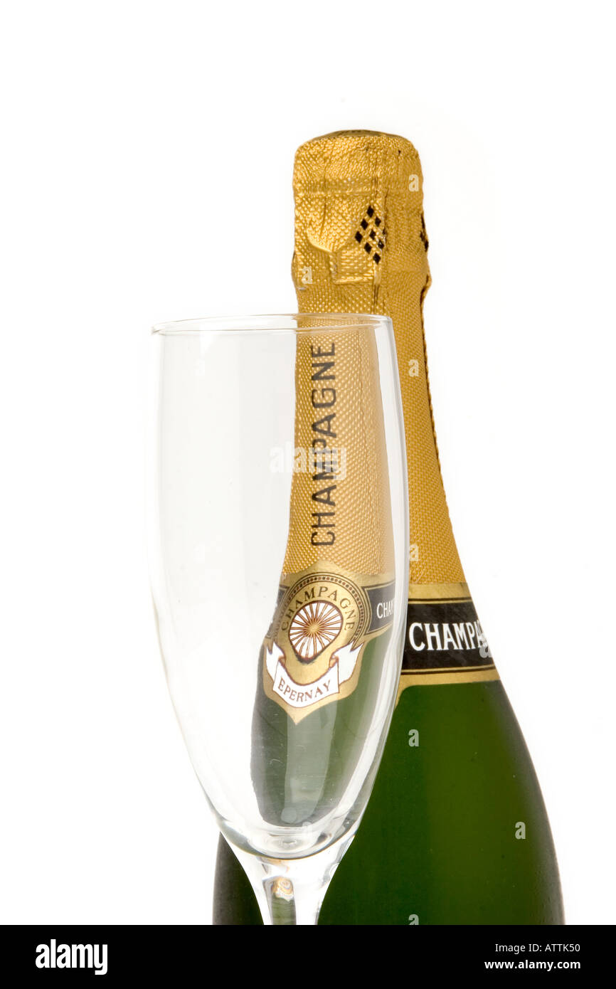 unopened bottle of champagne with one flute glass Stock Photo