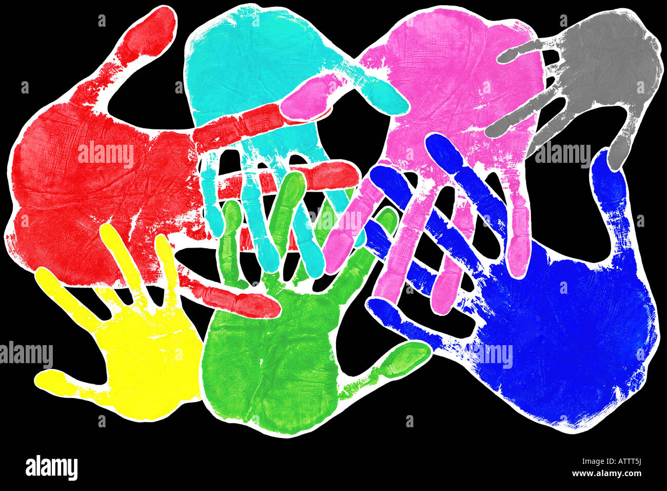 Hand prints in many colours with interlocking fingers on a black background - Stock Image