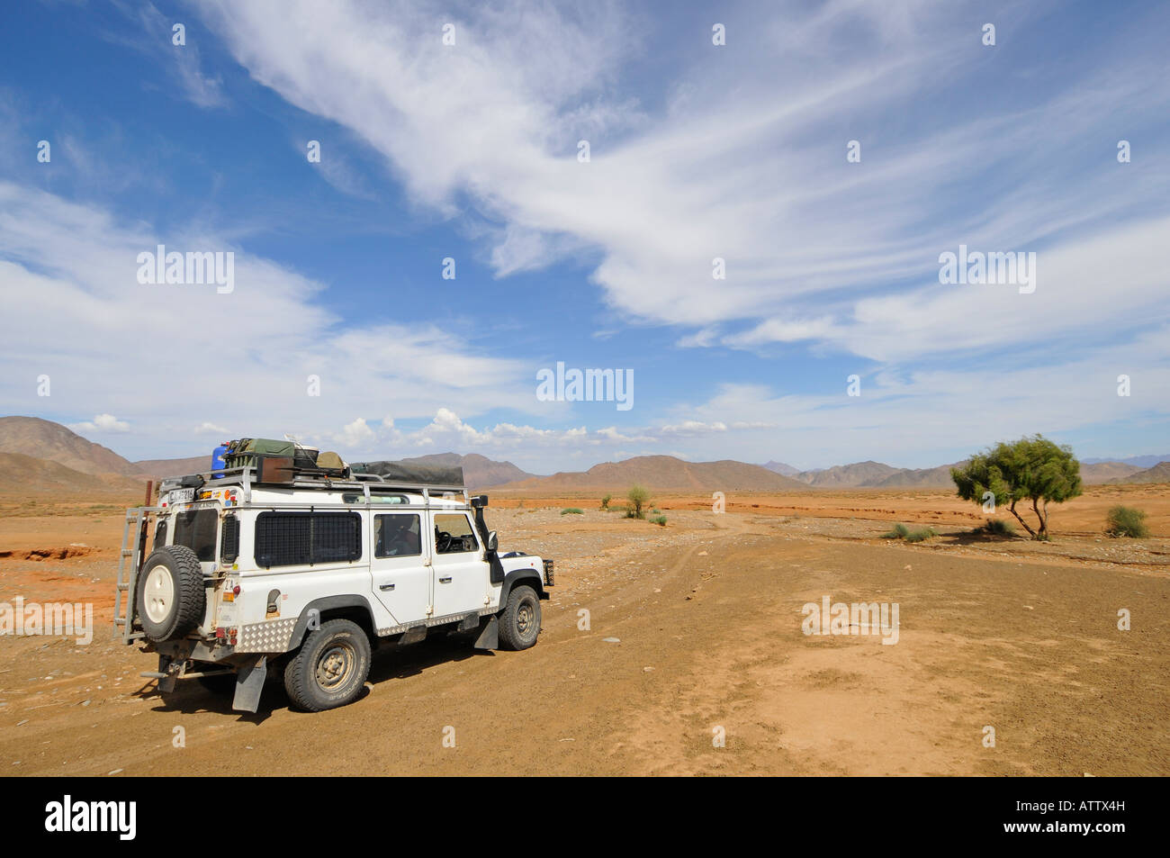 Ai Ais Richtersveld Transfrontier National Park at dried out river bed with Nama Land Rover - Stock Image