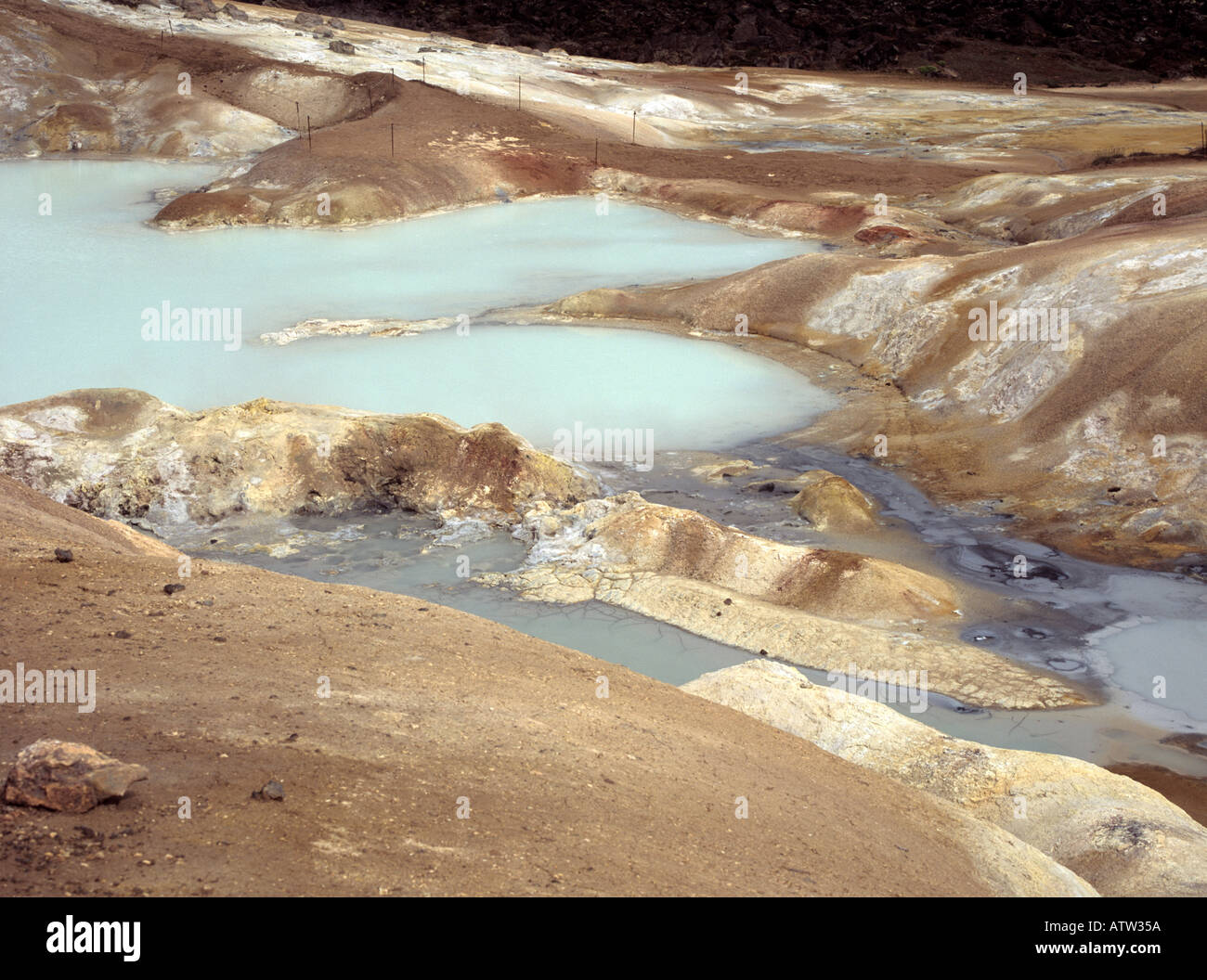 NAMAFJALL ICELAND EUROPE July High temperature geothermal area with black lava fumeroles mud pots and sulphur deposits Stock Photo