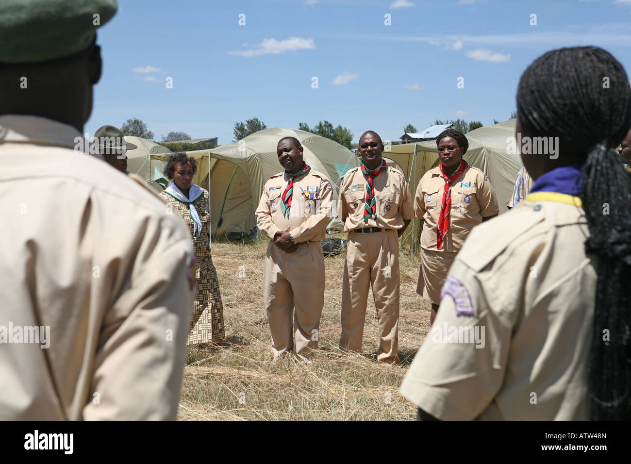 Member of Kenya's Scout Association are addressed by the district commissioner at an IDP camp in Nakuru Showground, - Stock Image