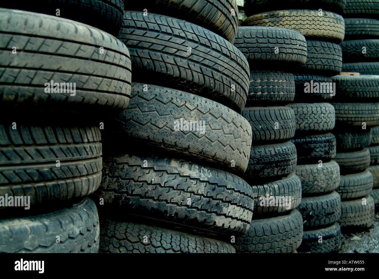 stack of used tyres - Stock Image