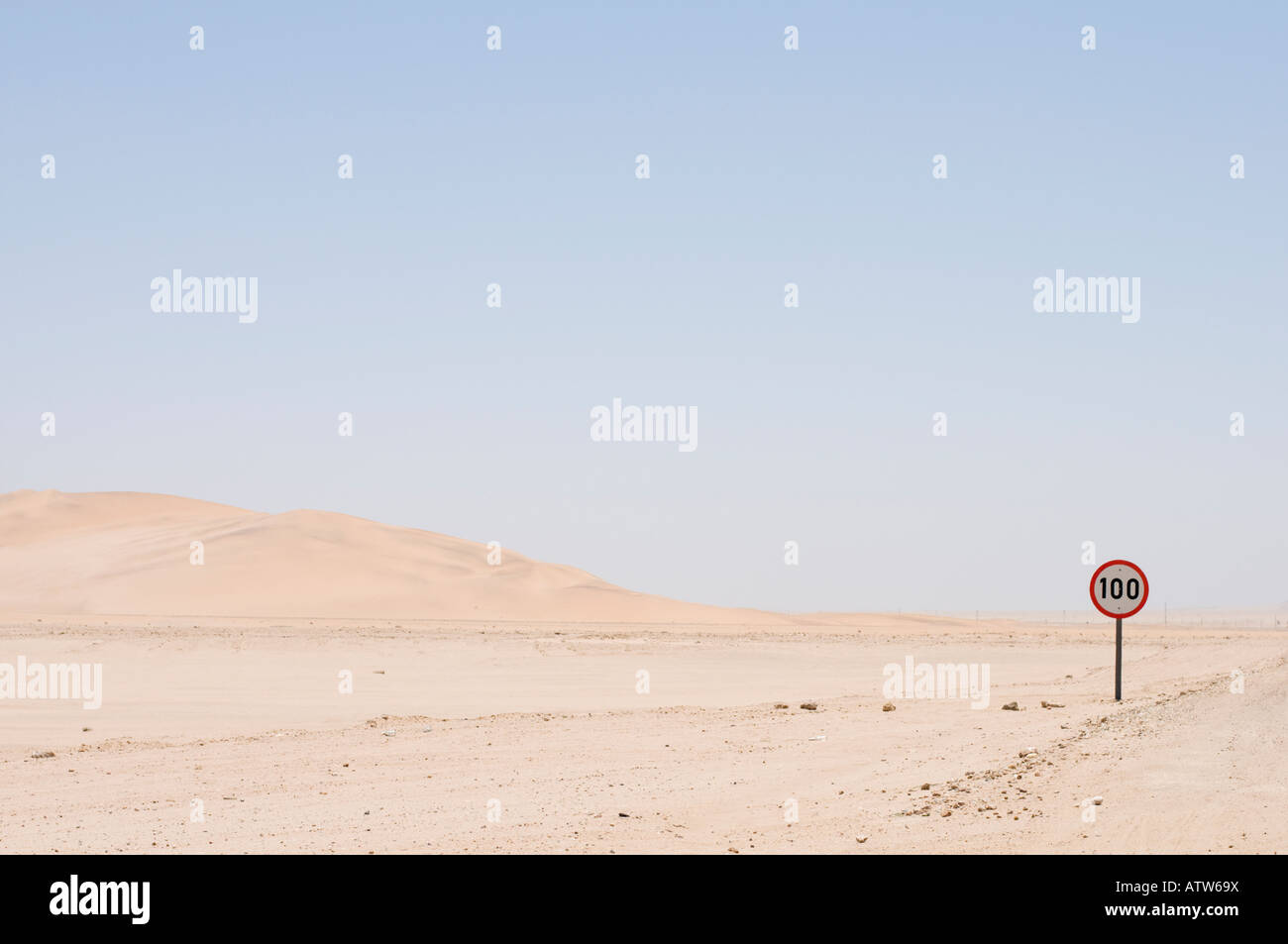 A speed limit sign in the middle of the Namib Desert Namibia Stock Photo