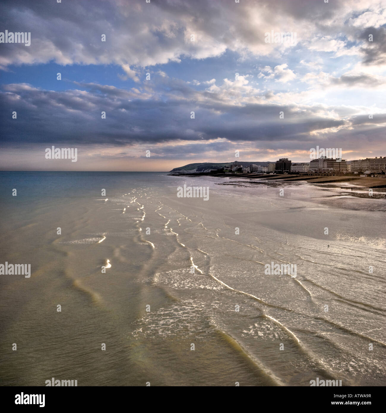 Eastbourne looking westwards from the pier with the incoming evening tide Stock Photo
