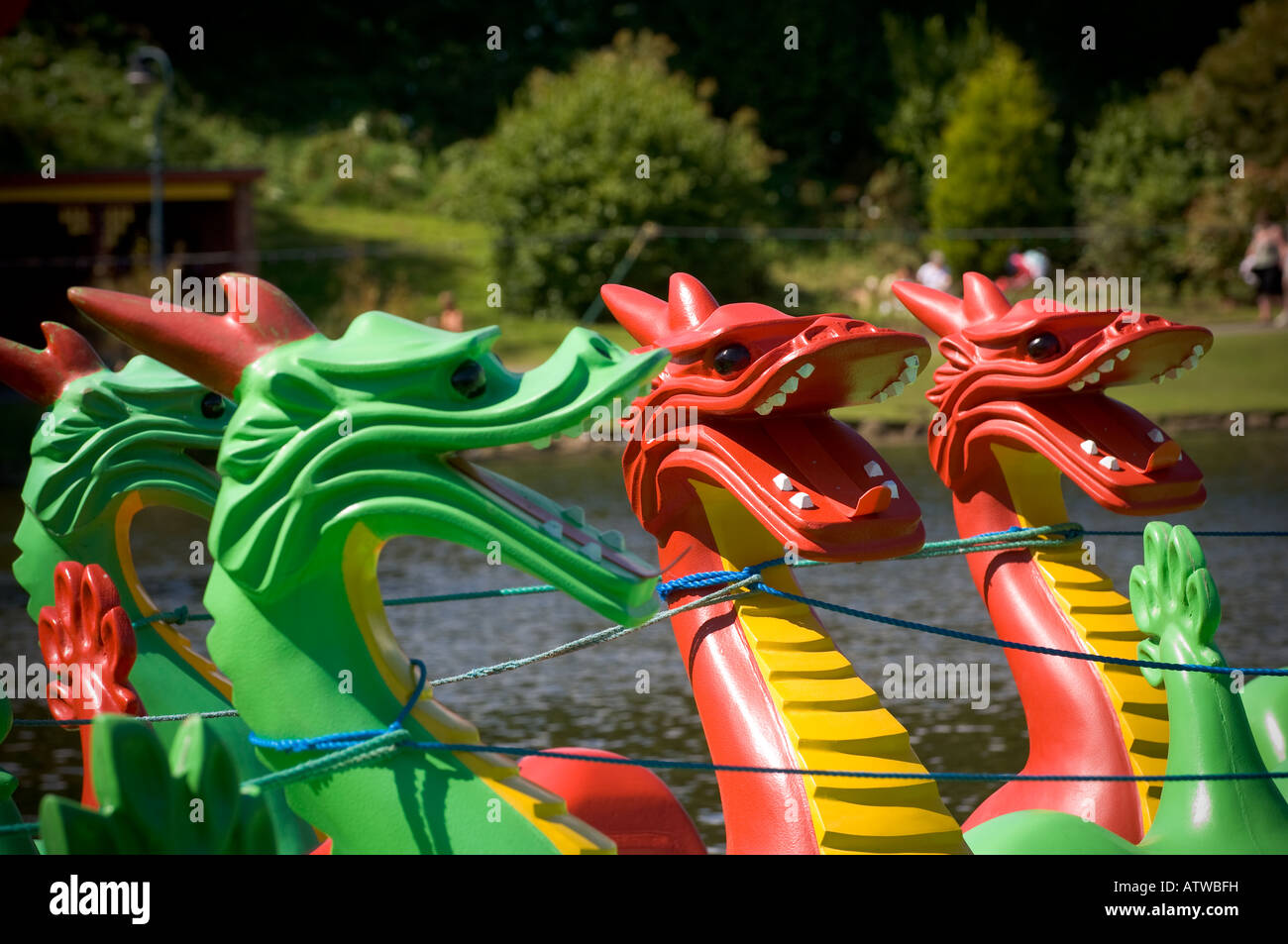Brightly coloured Painted wooden dragon heads on boats - Stock Image