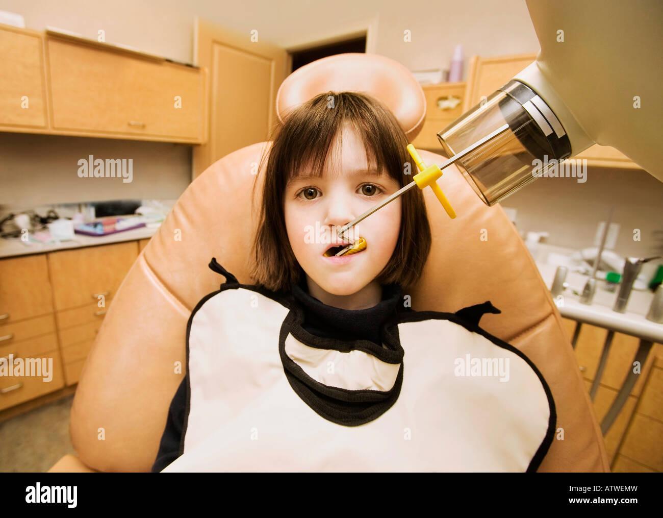 Girl getting dental x-ray - Stock Image